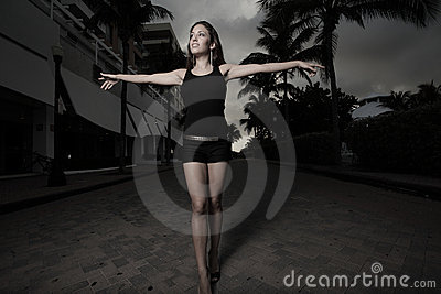 Woman walking with arms extended