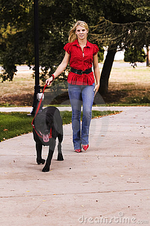 Woman walking black lab