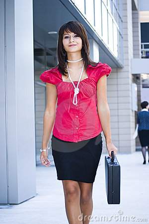 Woman walking with briefcase