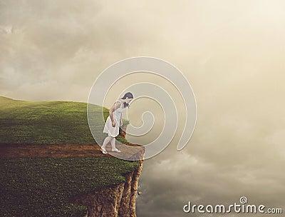 Woman walking on cliff.