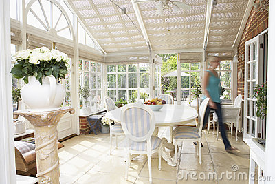 Woman Walking Through Conservatory