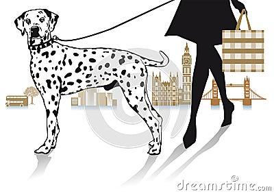 Woman walking a Dalmatian dog