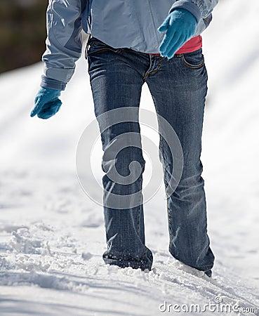 woman walking in deep snow