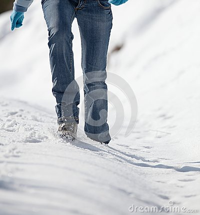 woman walking in deep snow