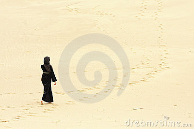 Woman walking by desert routes