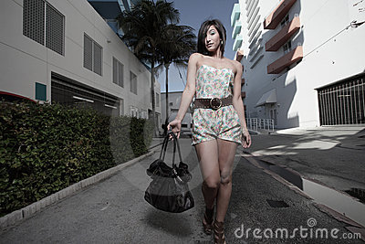 Woman walking down the alley