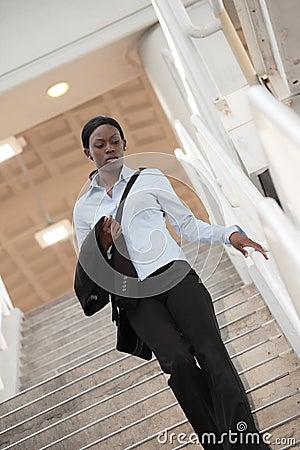 Woman walking down a staircase