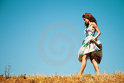 Woman walking through grass
