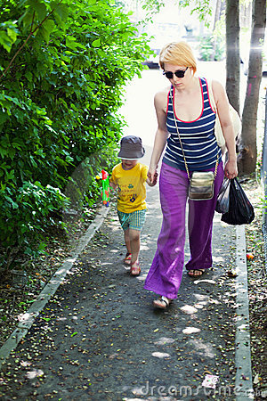 Woman walking with her son