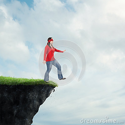 Woman walking off cliff