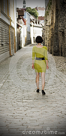 Woman walking in the Old Town of Tallinn
