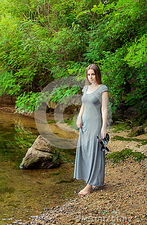 Free Woman Walking On The River Bank Stock Photo - 71064330