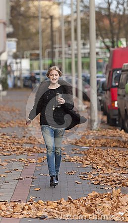 Free Woman Walking On The Street Royalty Free Stock Photo - 24519905