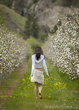 Woman Walking in Orchard