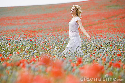 Woman Walking In Poppy Field Royalty Free Stock Images - Image: 5937199