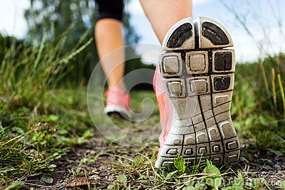 Woman walking or running, legs and shoes