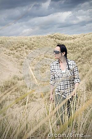 Woman walking in sand dunes