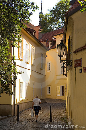 Woman walking through street in old europe