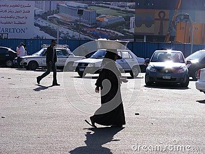 Woman walking in tahrir square Editorial Stock Photo