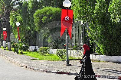 Woman walking on Tunisian street decorated Editorial Photo