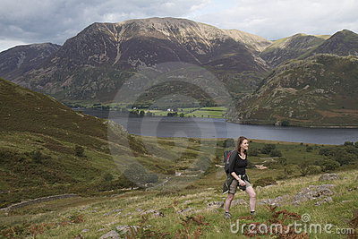 Woman walking up Red Pike in the Lake District