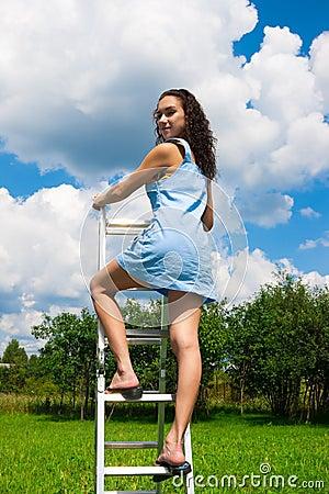 Woman walks upstairs to the sky