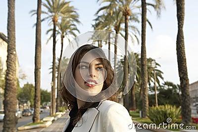 Woman on Walkway in City