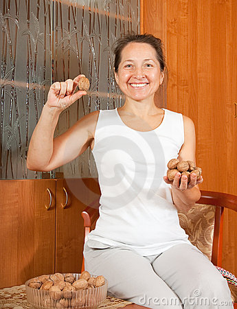 Woman with walnuts