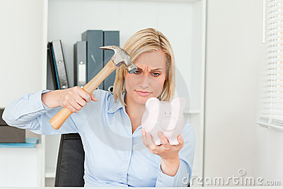 Woman wanting to destroy her piggy bank