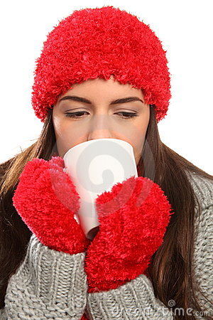 Woman in warm festive woolly hat with hot drink