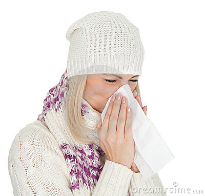 Woman in warm winter clothing sneezing from cold