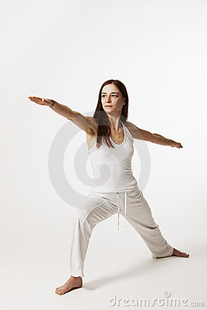 Woman in warrior pose (Virabhadrasana)