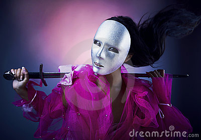 Woman warrior in a silver mask with a sword