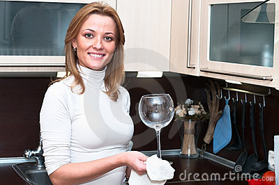 Woman washing wineglass
