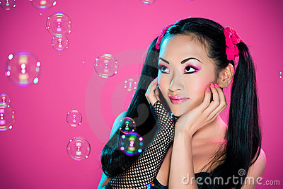 Woman watching bubbles