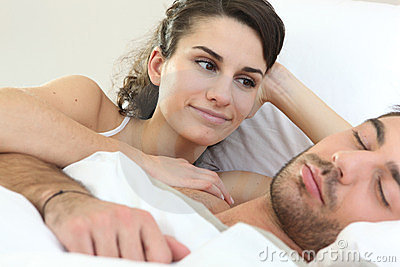 Woman watching her partner sleep