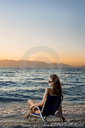 Woman watching sunset on the beach