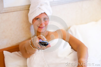 Woman watching TV on her bed