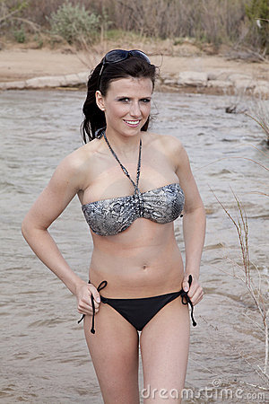 Woman in water silver bikini