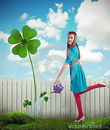 Free Woman Watering A Four Leaf Clover Royalty Free Stock Image - 29335636