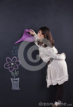 Woman watering a drawing plant