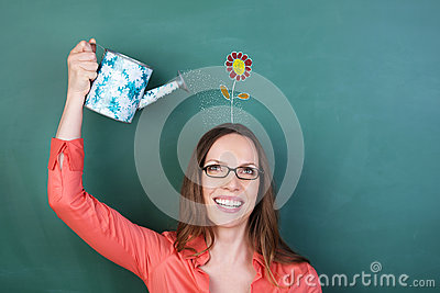 Woman watering a flower on her head