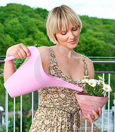Woman watering flower plant