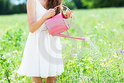 Woman watering flowers