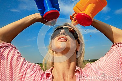 Woman watering herself