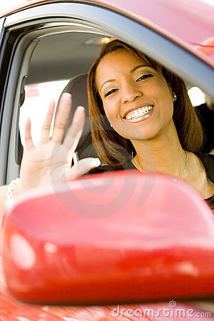 Woman waving out of car window