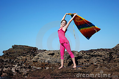 Woman waving shawl in air