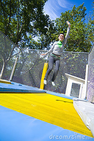 Woman waving on trampoline