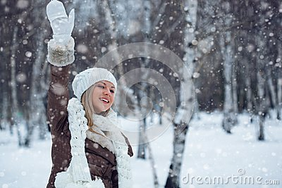 Woman waving in winter park
