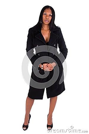 Woman wearing black coat.